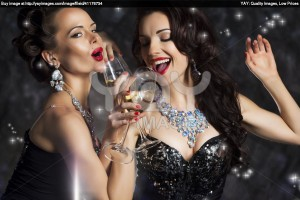 happy-laughing-women-drinking-champagne-and-singing-xmas-song-2744e9e